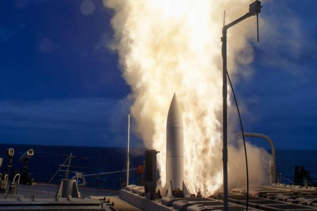An SM-6 missile launches from the deck of USS John Paul Jones during a test in June 2014. Raytheon was awarded a $12.1 million modified contract for the SM-6 and SM-2. Photo by U.S. Navy