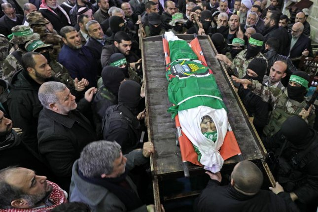 Members of Haamas carry the body of Hamas senior leader Imad al-Alami in al-Omari mosque during his funeral in Gaza City on Tuesday. Photo by Mohammed Saber/EPA-EFE