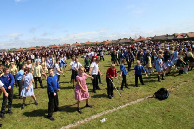 Students at Montgomery Academy in Blackpool, England, broke a world record by performing the popular floss dance move simultaneously. Photo courtesy of Guinness World Records