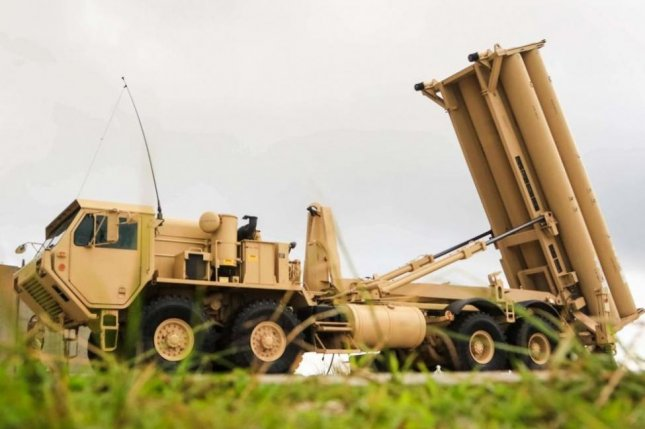 The Terminal High Altitude Area Defense weapon system, pictured at Andersen Air Force Base in Guam, consists of a launcher, interceptors, fire control and communications equipment, and the AN/TPY-2 tracking radar. File Photo by Capt. Adan Cazarez/U.S. Army