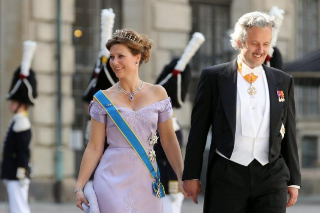 Author Ari Behn, right, with Princess Martha Louise of Norway in 2013. The Norwegian Royal Palace said Wednesday that Behn, who was divorced from the princess, died by suicide. Photo by Soren Andersson/EPA