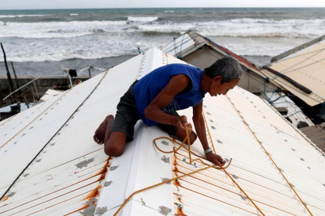 A resident of Aparri, Cagayan province, Philippines, secures his roof on Friday in anticipation of Typhoon Mangkhut, which is approaching the Philippines with 180-mile winds. Photo by Rancis R. Malasog/EPA-EFE