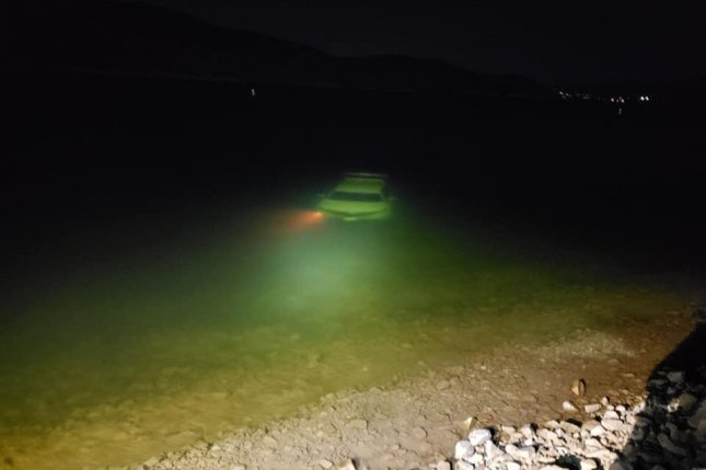 A visitor to Deer Creek State Park in Utah got out of his car to take some photos of the vehicle on a boat ramp when the car rolled into the water. Photo courtesy of Wasatch County Search & Rescue/Facebook