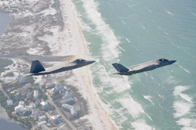 A F-22 Raptor from the 325th Fighter Wing flies alongside a F-35 Lightning II from the 33rd Fighter Wing over the Emerald Coast in Florida, where Tyndall Air Force Base has been selected to host three F-35 squadrons. Photo by Savanah Bray/U.S. Air Force
