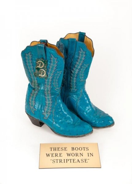 Burt Reynolds wore these blue boots for his role in Striptease. They are part of his auction to raise money for bills. Photo courtesy Julien's Auctions