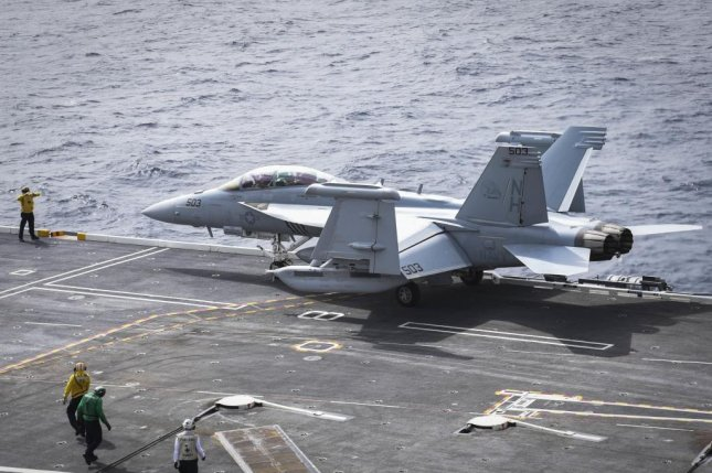 Boeing's contract with the U.S. Navy includes seven EA-18G aircraft and five F/A-18E fighters. Pictured, a Sailor directs an EA-18G Growler on the flight deck of the USS Nimitz. U.S. Navy photo by Seaman Cody M. Deccio