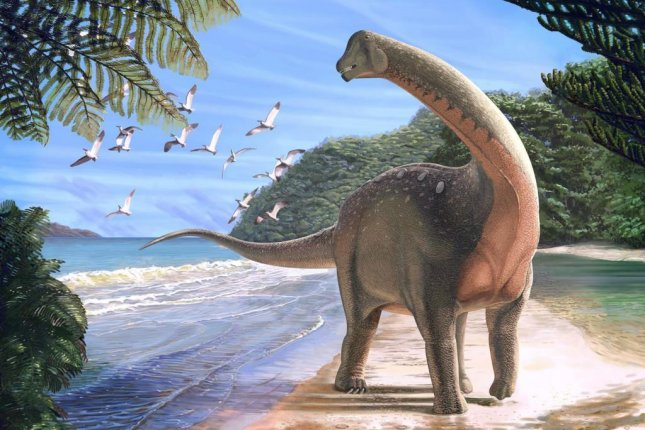 An artistic rendering shows the titanosaurian dinosaur species Mansourasaurus shahinae on the coast of Egypt some 80 million years ago. Photo by Andrew McAfee/Carnegie Museum of Natural History