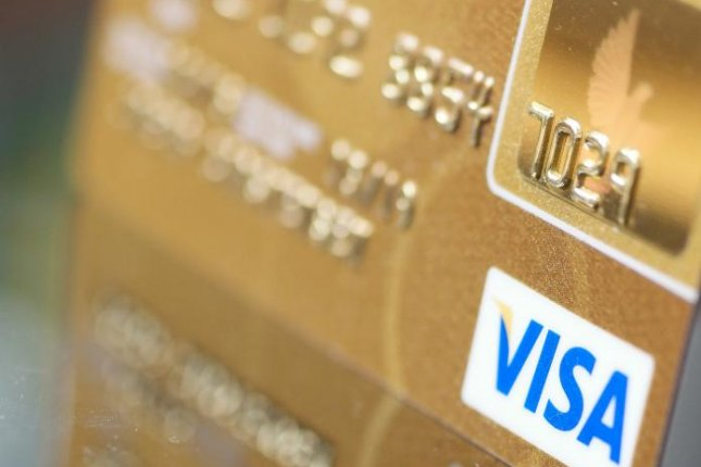 Visa and Mastercard reached a $900 million settlement in the long-standing class-action suit over credit card-swipe fees. Photo by Joerg Carstensen/EPA