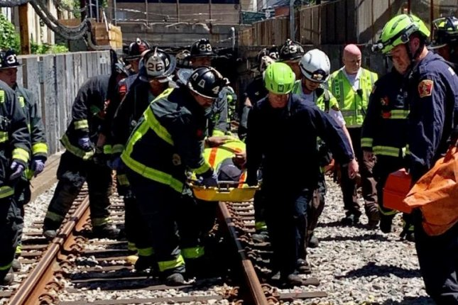 Boston firefighters had to carry multiple people in stoke baskets from the tunnel after a train derailment in a tunnel in Boston. Photo courtesy Boston Fire Department/Twitter