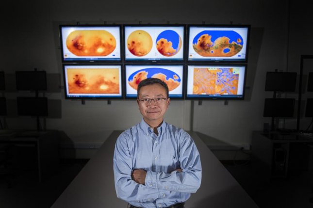 Professor Wei Luo developed a model to predict how much water it took to carve out the ancient valley system on Mars. Photo by NIU