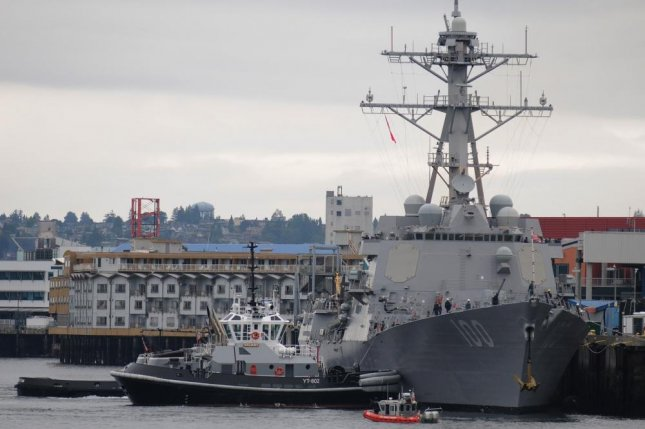 Eighteen sailors assigned to the the Aleigh Burke-class guided-missile destroyer USS Kidd, shown here during a port visit to Seattle in 2010, have tested positive for COVID-19. Photo by Nardel Gervacio/U.S. Navy