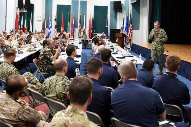 Led by Rear Adm. Curt Renshaw, R, the U.S. Naval Forces Central Command addresses senior military leadership from countries participating in International Maritime Exercise 19. The three-week exercise began on Monday. Photo by MCS1 Jason Abrams/U.S. Navy