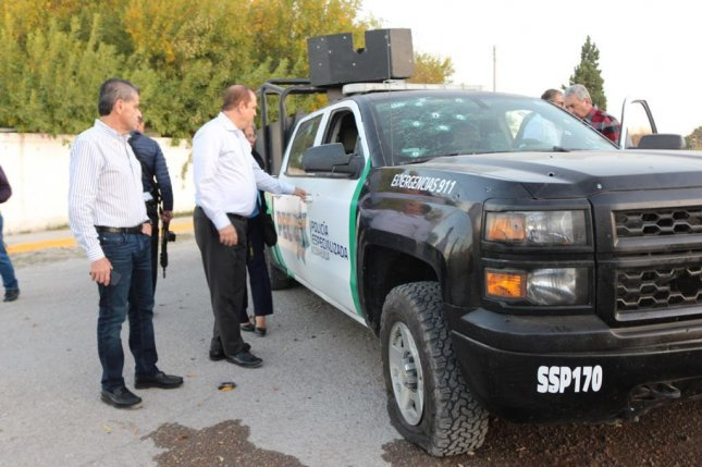 Government officials from the Mexican state of Coahuila survey the site of a clash between security forces and alleged Mexican cartel members that left 21 people dead on Sunday. Photo courtesy Government of Coahuila