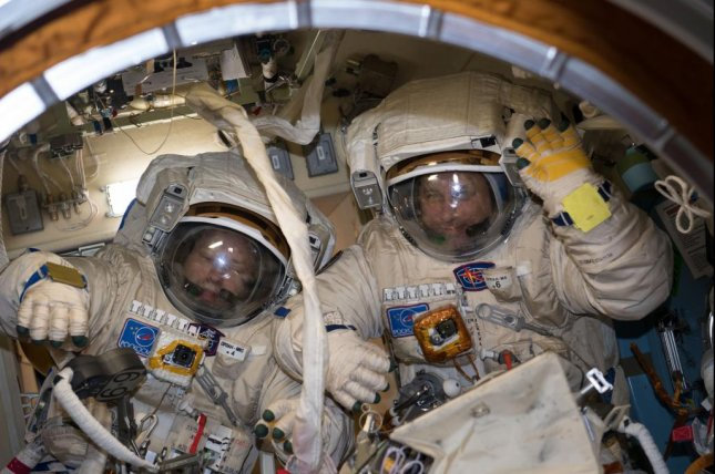Cosmonauts Alexander Misurkin, on the left, and Anton Shkaplerov are photographed trying on their spacesuits prior to Friday's spacewalk. Photo by NASA