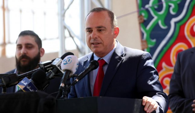 Israeli Minister of Energy Yuval Steinitz speaks during an opening ceremony of an electrical substation near the West Bank city of Jenin last July. This week, Steinlitz said Israel plans to eliminate coal by 2030. File Photo by Alaa Badarneh/EPA