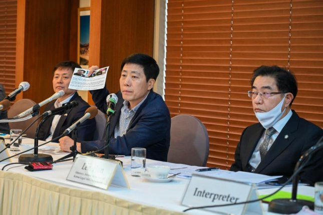 From left to right, defectors Park Jung-o and Park Sang-hak and attorney Lee Hun defend sending leaflets to North Korea at a press conference on Monday. Photo by Thomas Maresca/UPI