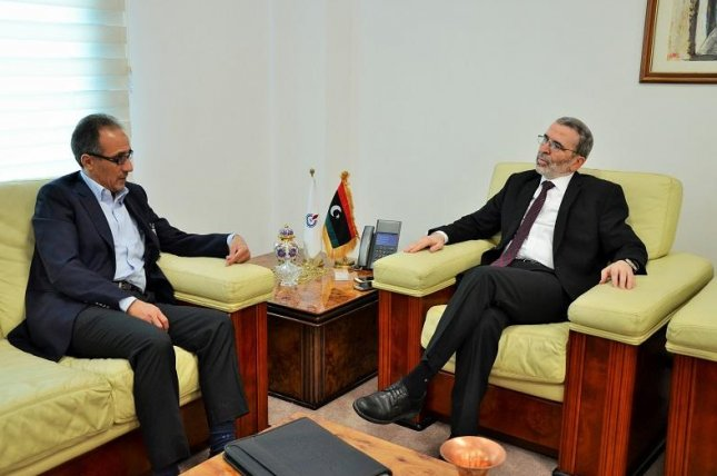 The head of the National Oil Co. in Libya, Mustafa Sanalla (R), discusses potential options to boost production with a regional representative from Norwegian energy company Statoil. Photo courtesy of Libya's NOC