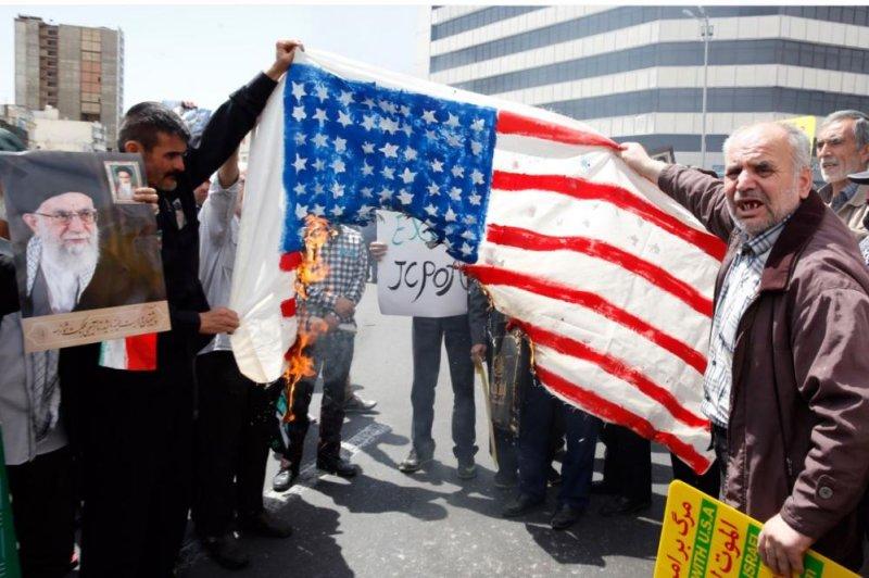 Demonstrators burn a U.S. flag in Tehran, Iran, Friday amid national rallies supporting Iran's rejection of U.S. sanctions. Photo by Abedin Takerkenareh/EPA-EFE