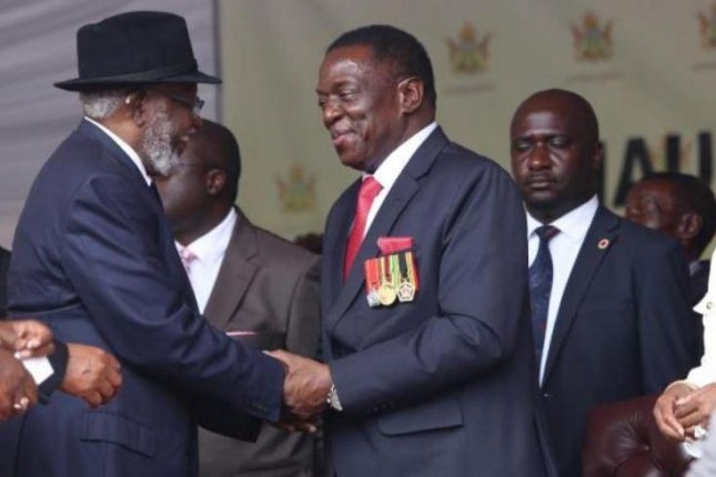 Zimbabwean President Emmerson Mnangagwa, C, here at his November 24 inauguration, appointed party and military loyalists to his cabinet on Friday. Photo by Aaron Ufumal/EPA