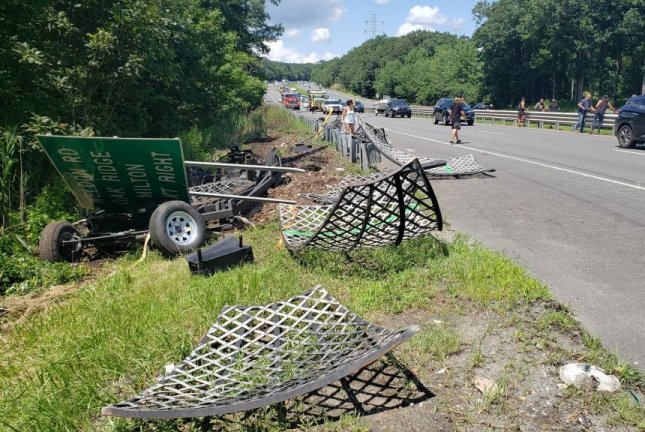 A circus stunt cage known as the Globe of Death fell from a trailer onto a New Jersey highway, where it broke into pieces. Photo courtesy of the Jefferson Township Police Department