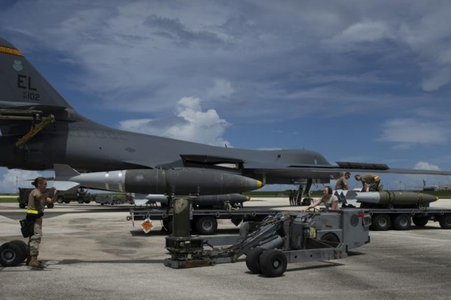 Load-crew members use a munitions lift truck to load a GBU-38 Joint Direct Attack Munition into a B-1B Lancer during a 16-hour Bomber Task Force mission to Australia from Andersen Air Force Base, Guam on Aug. 5. Photo by Christina Bennett/U.S. Air Force