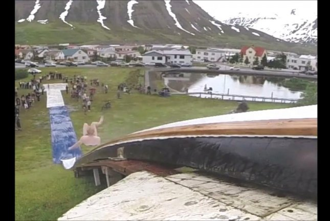 Giant water slide set up in Icelandic village ahead of National Day