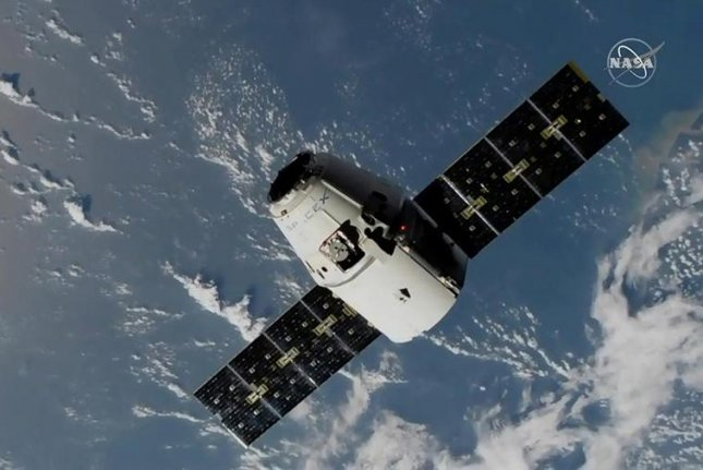 The SpaceX Dragon resupply ship approaches the International Space Station over the Atlantic Ocean on Sunday morning. Photo courtesy NASA