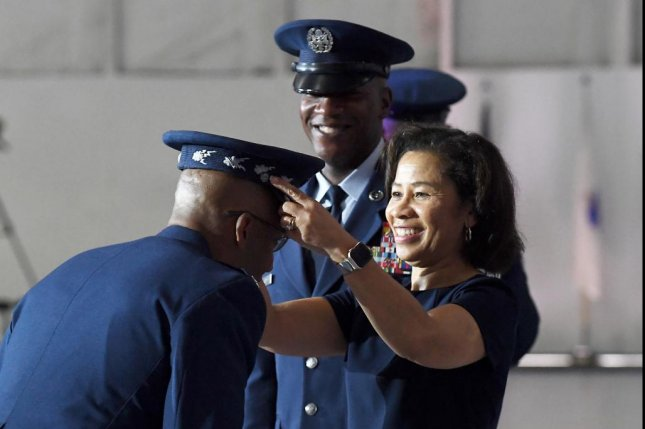 Sharene Brown, spouse of incoming Air Force Chief of Staff Gen. Charles Q. Brown, Jr., presents the official Air Force Chief of Staff service cap to her husband during the CSAF transition ceremony at Joint Base Andrews, Md., Aug. 6, 2020. Brown is the 22nd Chief of Staff of the Air Force. Photo by Chad Trujillo/U.S. Air Force