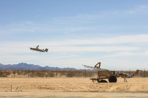 A Marine Corps RQ-21 Blackjack unmanned aerial vehicle is launched from its catapult. Photo by Lance Cpl. Andrew Huff/U.S. Marine Corps