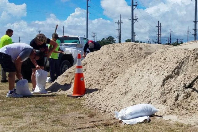 People in Myrtle Beach, S.C., fill bags of sand to protect their property from flooding in preparation for Hurricane Florence. Photo courtesy of City of Myrtle Beach/Twitter