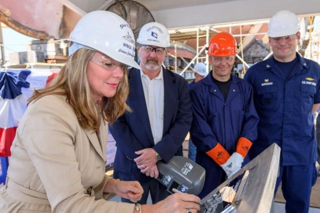 Huntington Ingalls Industries conducted a keel authentication ceremony for the newest U.S. Coast Guard cutter, the USCGC Calhoun, with Christine Calhoun Zubowicz, L, the namesake's granddaughter, serving as the ship's sponsor. Photo courtesy of Huntington Ingalls Industries