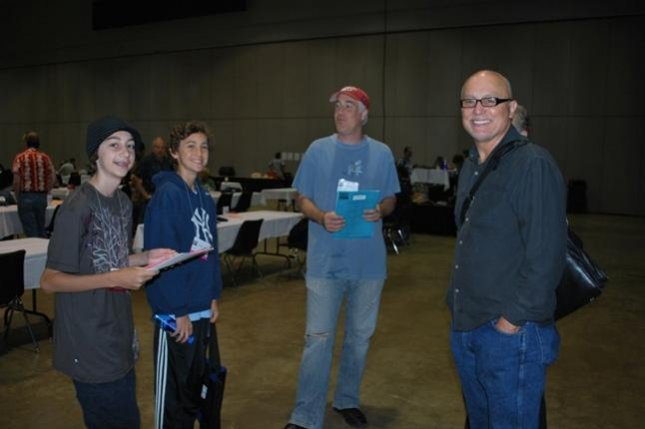 Tristan Vanech (2nd from Left) of Venice, California, chats with father Bob Vanech (C) at a 2009 Scrabble Tournament. Source: National Scrabble Association