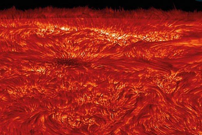 Produced by the interaction between magnetic fields and plasma, sonic boom-like shock waves rip through the sun's atmosphere, yielding extreme heat. Photo by Queen's University Belfast