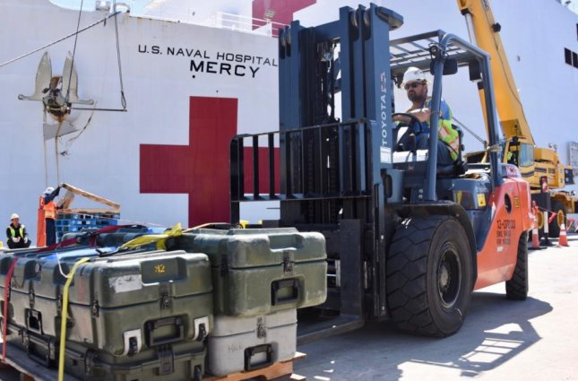 Cargo is loaded aboard the USNS Mercy, a Navy hospital ship, prior to its travel from San Diego to Los Angeles on Monday to alleviate pressure on local hospitals dealing with the COVID-19 outbreak. Photo by MCS2 Jessica Paulauskas/U.S. Navy
