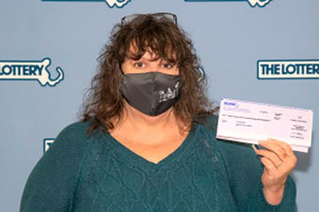 Lea Rose Fiega, of Springfield, Mass., threw away aDiamond Millions scratch-off lottery ticket at theLucky Stop store in Southwick, but the owners of the store held on to the ticket and returned it to her when they discovered it was a $1 million winner. Photo courtesy of the Massachusetts State Lottery