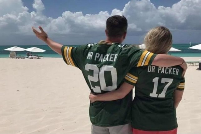 A die-hard Green Bay Packers fanatic took on his wife's life name to officially become Mr. Packer. Screenshot: TMJ4/AOL