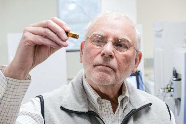 Environmental toxicologist John Giesy looks at a liquid crystal monomer sample in his lab at the USask Toxicology Center. Photo by Hallen/USask