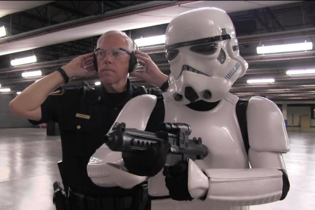 A Stormtrooper gets a shooting lesson from a Fort Worth police officer. Screenshot: Fort Worth Police Department/Facebook