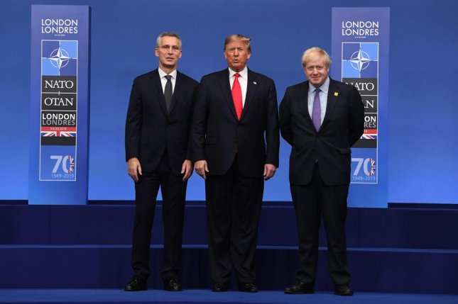 U.S. President Donald Trump poses Wednesday with British Prime Minister Boris Johnson (right) and NATO Secretary-General Jens Stoltenberg during the NATO summit Wednesday in London. Photo by Facundo Arrizbalaga/EPA-EFE