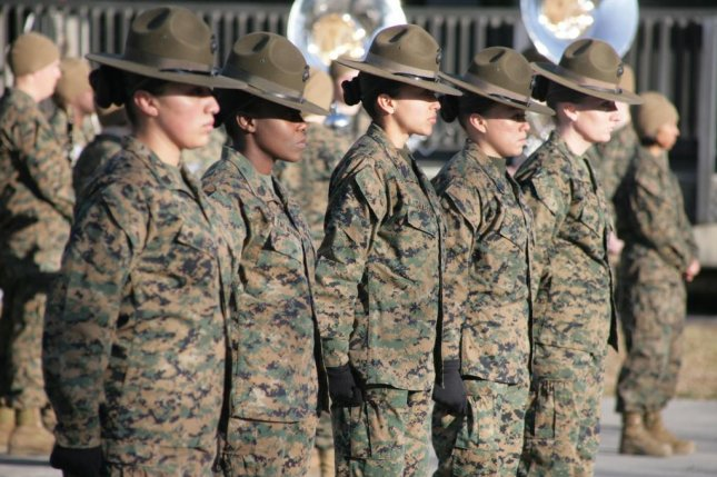 U.S. Marine Corps drill instructors with the 4th Recruit Training Battalion, Marine Corps Recruit Depot Parris Island, stand at parade rest during the 69th anniversary of women in the Marine Corps, aboard Marine Corps Recruit Depot Parris Island, S.C., Feb. 13, 2012. The U.S. Marine Corps and the U.S. Navy announced Monday all available jobs will be opening to women. USMC photo by Lance Cpl. Vincent White