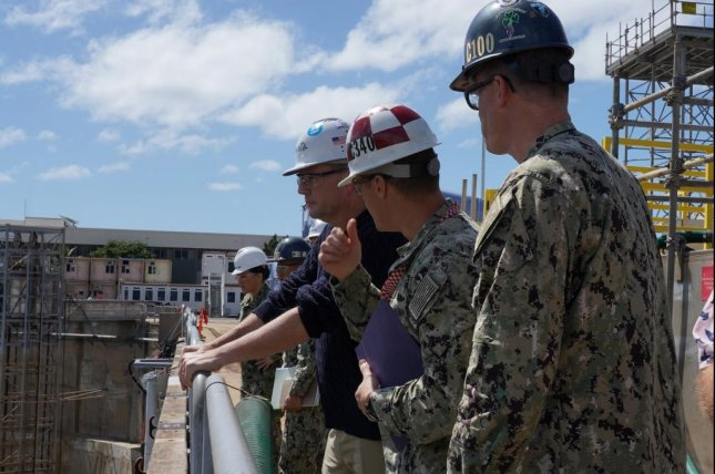 James F. Geurts, assistant secretary of the Navy for research, development and acquisition, looks into Pearl Harbor Naval Shipyard and Intermediate Maintenance Facility's Dry Dock #3. Photo courtesy of U.S. Navy