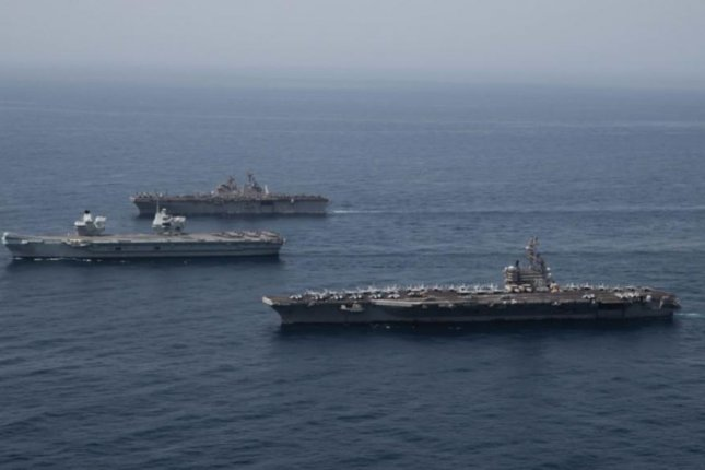 The aircraft carrier USS Ronald Reagan, foreground, joined ships of its carrier strike group in anti-submarine warfare exercises in the Arabian Sea. Photo courtesy of U.S. Navy