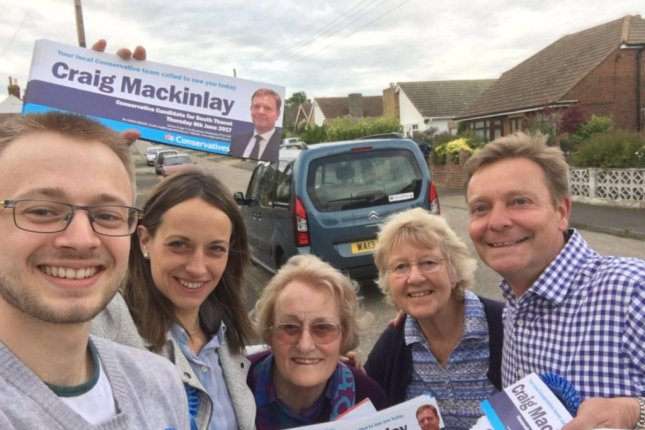 Conservative British lawmaker Craig Mackinlay (R) poses with campaign volunteers. Mackinlay was charged with violating British campaign spending limits during his 2015 campaign. Photo courtesy Craig Mackinlay via Twitter