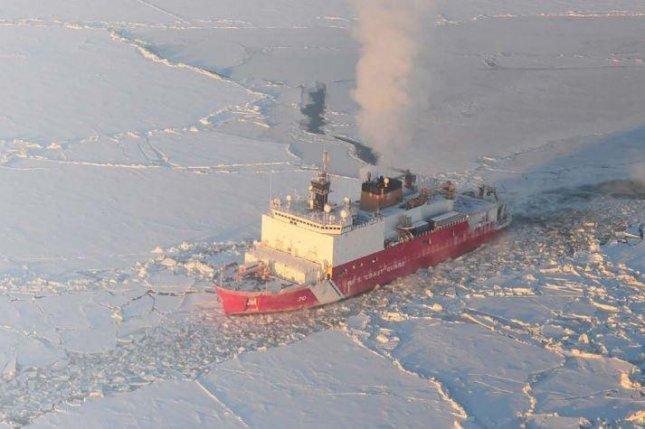 A U.S. Coast Guard ship cuts through Arctic Ocean ice. The Defense Department awarded a $945.9 million contract to VT Halter Maritime Inc. to design and build a new class of Polar Security Cutter. Photo courtesy of U.S. Coast Guard