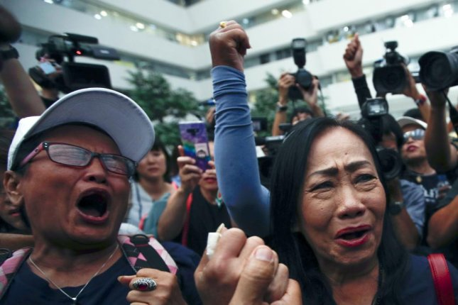 Thai Raksa Chart supporters in Bangkok, Thailand, react Thursday to the Constitutional Court's dissolution of the party. Photo by Rungroj Yongrit/EPA-EFE