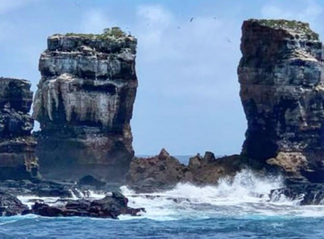 Darwin's Arch collapsed Monday, leaving two pillars about half a mile from Darwin Island in the Galapagos Archipelago. Photo courtesy of the Ecuadorian Ministry of Environment and Water
