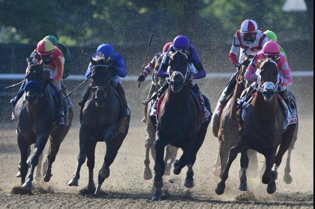 Vekoma (R) turns for home in the lead and on the way to victory in Saturday's Grade I Met Mile at Belmont Park. Photo by Elsa Lorieul, courtesy of New York Racing Association