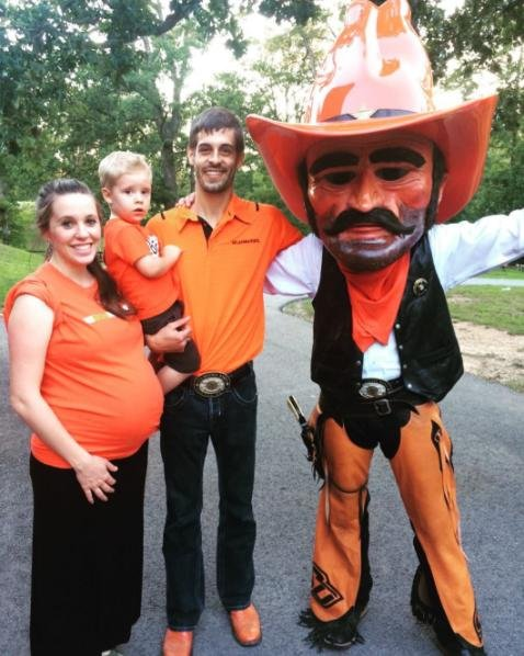 Jill Duggar (L) with son Israel, husband Derick Dillard and the Oklahoma State mascot Pistol Pete on Tuesday. The reality star confirmed her unborn baby's name the same day. Photo by Jill Duggar/Instagram
