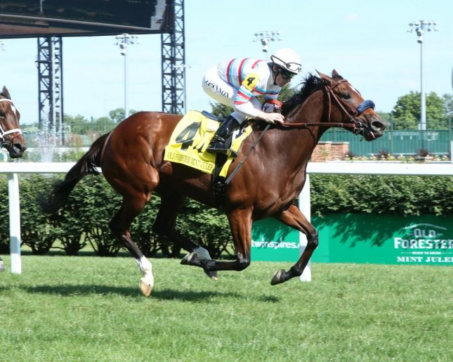 Argentine-bred Dona Bruja, seen winning he Mint Julep Handicap in June at Churchill Downs, returns to the scene of that triumph to contest Saturday's Cardinal Handicap. (Churchill Downs photo)
