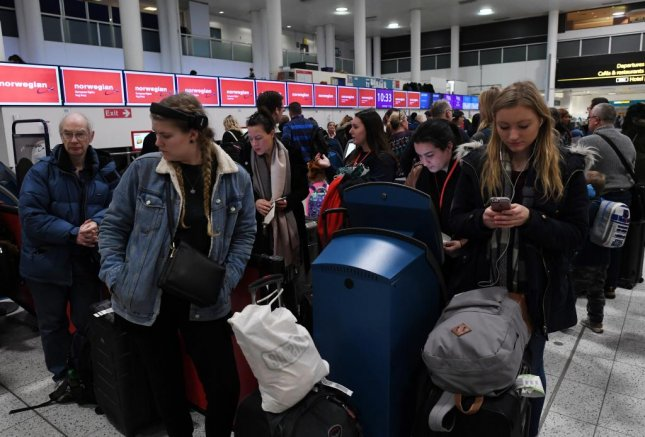 Passengers arrive in Gatwick Airport in Sussex, England on Friday after flights were grounded for 36 hours last week, following drone sightings near the runway Wednesday night. Two people arrested in connection with the incident have since been released without charges. Photo by Facundo Arrizabalaga/EPA-EFE